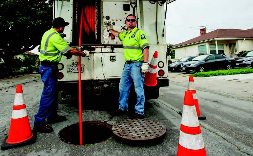 workers by cones